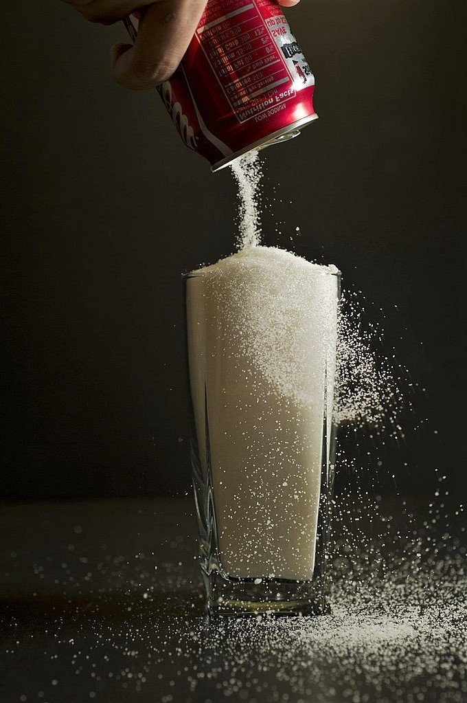 Soft drinks contain more sugar than people think. An average 12-fluid ounce can of soda has 40 grams of sugar, or the equivalent of 20 sugar cubes. According to the U.S. Department of Health and Human Services, Americans should try to limit the amount of sugar intake as part of a healthy and balanced nutritional plan.